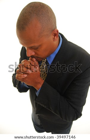 African American man preying, isolated on white. - stock photo