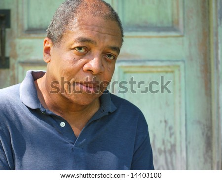 African american man returns to the house he was abused in. - stock photo