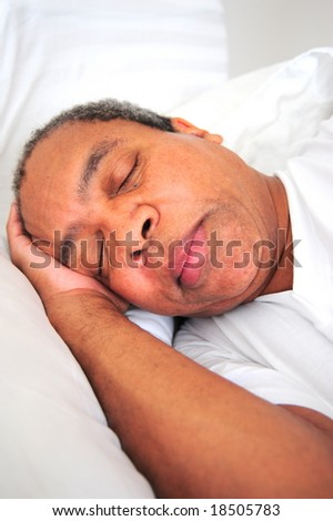 African American man sleeping.