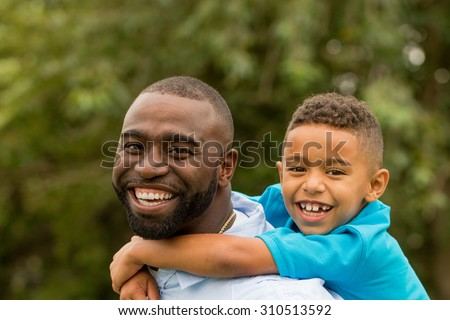 African American man spending time with his son. - stock photo