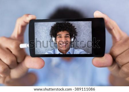 African American man taking selfie  - stock photo