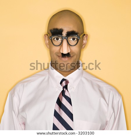 African American man wearing groucho mask disguise. - stock photo