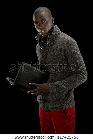African american man with a tablet PC and wearing a sweater and red pants.