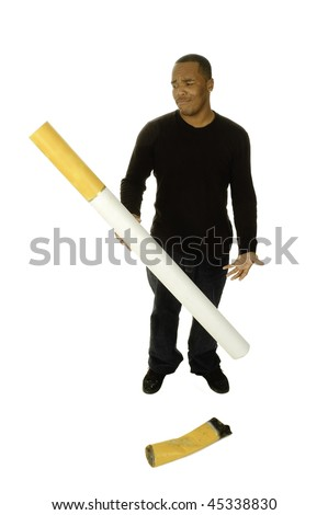 african american man with giant cigarette looking in disgust at filter for an anti smoking campaign - stock photo