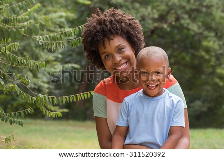 African American mom spending time with her son. Mother and son. Single parent. Family. - stock photo