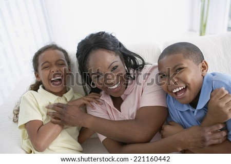 African American mother and children laughing - stock photo