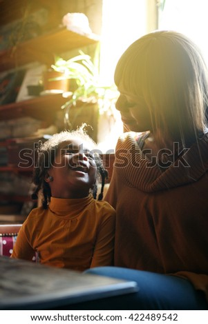 African American mother and daughter having fun at home.  - stock photo