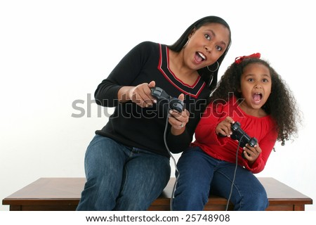 African American mother and daughter playing video games. - stock photo
