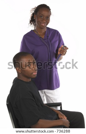 African American nurse with stethoscope standing with a male African American patient