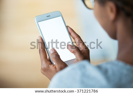 African american person holding a tactile mobile smartphone - Black people - stock photo