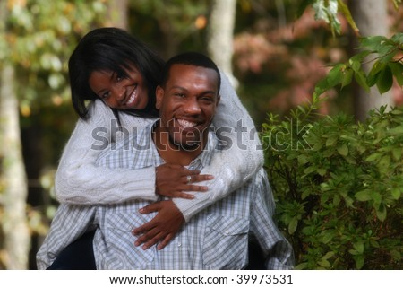 African-American playful couple outside bonding together - stock photo
