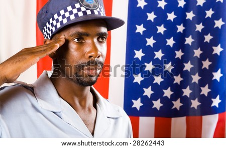 african american policeman saluting, background is USA flag