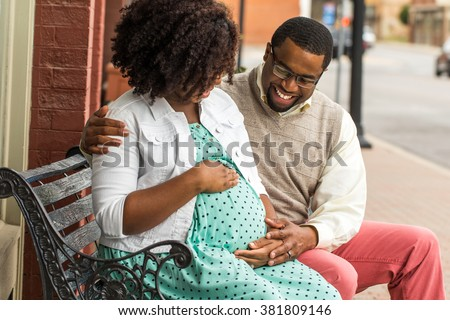 African American Pregnant Woman Outside. - stock photo