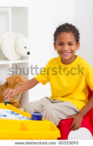 african american preschool boy in classroom - stock photo