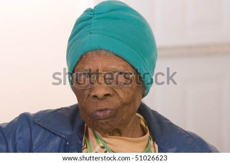 African American senior citizen looking to the side unsure of something. - stock photo