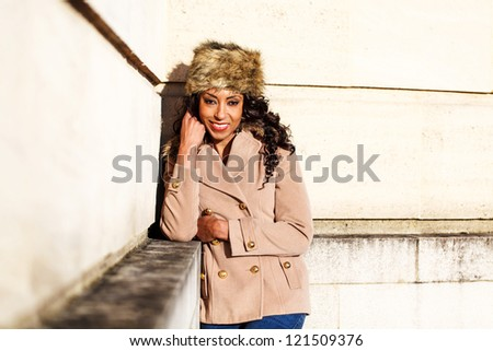 African American smiling woman out in the winter sun - stock photo