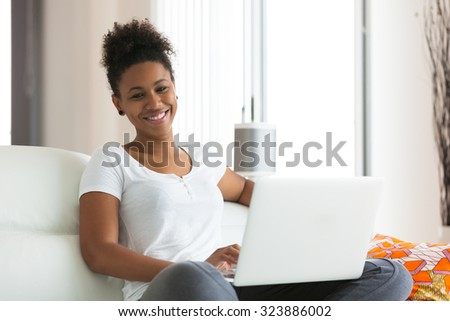 African American student girl using a laptop computer - black people - stock photo