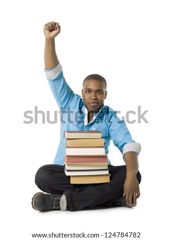 African american student with books raising his fist