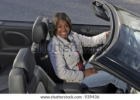 african american teen driving in convertible auto - stock photo