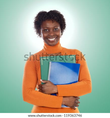 African-American university student isolated on a over green background
