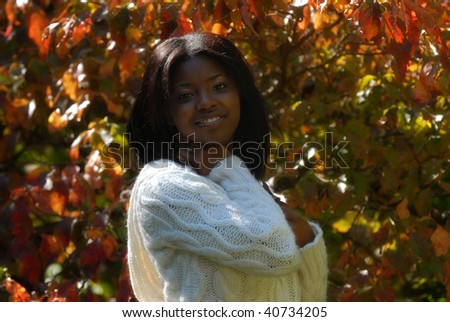 African-American woman around bold fall colors