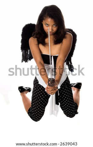 African American woman as a Ninja Angel ready to attack with her sword - stock photo