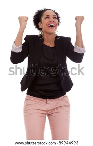 African american woman celebrating success with clenched fists on white background - stock photo