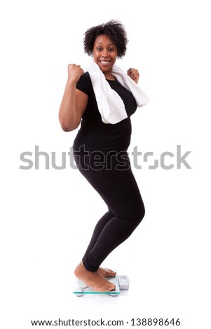 African American woman cheering on scale isolated over white background - African people - stock photo
