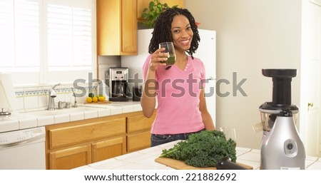 African American woman drinking freshly made juice - stock photo