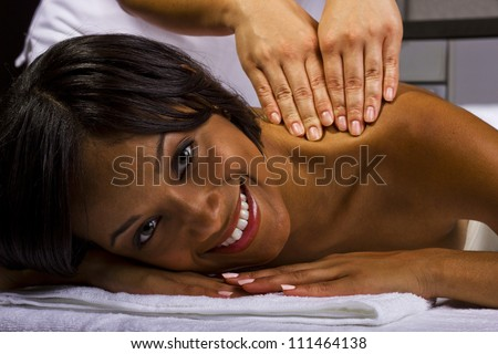 African American woman getting a massage
