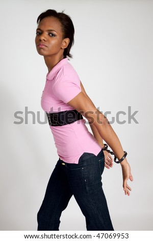 African american woman handcuffed - stock photo