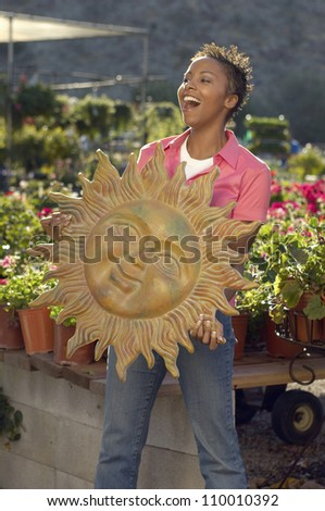 African American woman holding sun's sculpture - stock photo