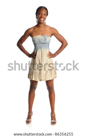 African American woman in dress standing isolated over white background - stock photo
