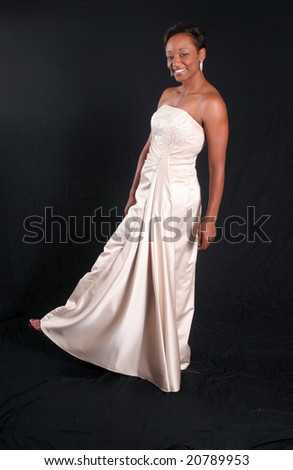 African american woman in formal dress, kicking up her right foot - stock photo