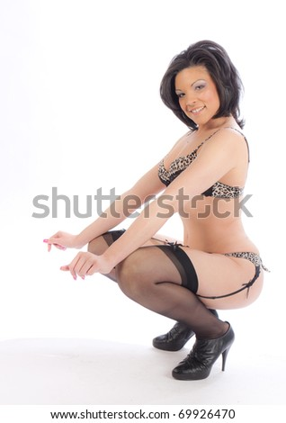 African American woman in lingerie on white floor - stock photo