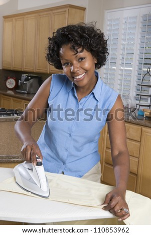 African American Woman Ironing - stock photo