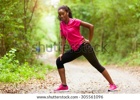 African american woman jogger stretching  - Fitness, people and healthy lifestyle - stock photo