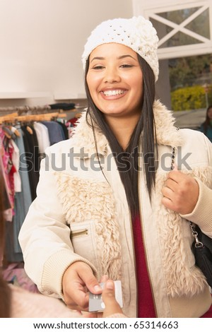 African American woman making credit card purchase at boutique - stock photo