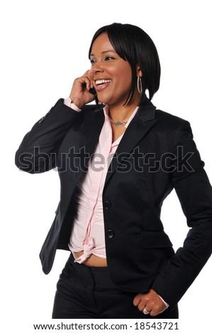 African American woman on the cell phone smiling against a white background - stock photo