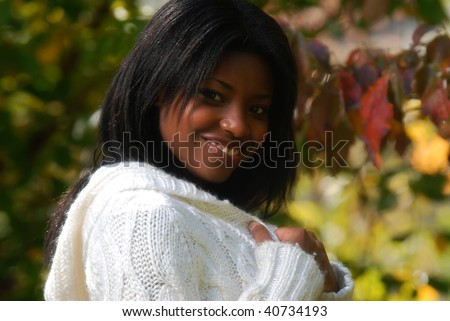 African-American woman outside on a fall day - stock photo