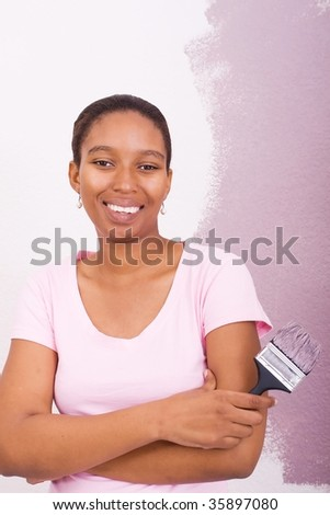 african american woman painting house - stock photo
