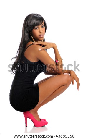 African American woman posing wearing a black dress and high heels - stock photo