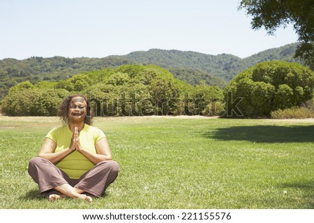 African American woman practicing yoga - stock photo