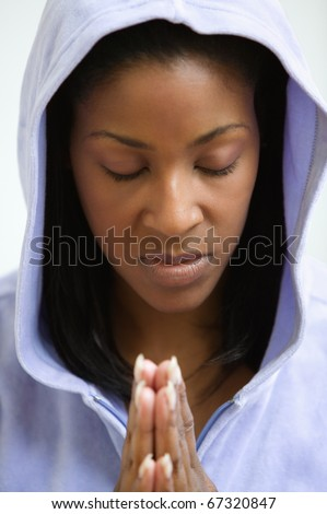 African American woman praying