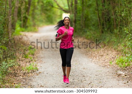 African american woman runner jogging outdoors - Fitness, people and healthy lifestyle - stock photo