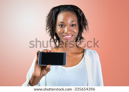 African American Woman showing a mobile phone - stock photo