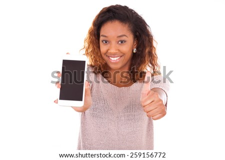 African American Woman showing a mobile phone and making thumbs up - stock photo