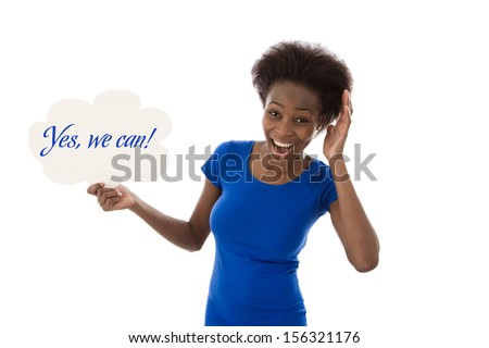 """African American woman standing with speech balloon says """"Yes, we can!"""", isolated over white background. - stock photo"""