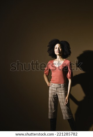 African American woman with hand on hip - stock photo