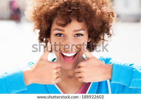 African American woman with thumbs up  - stock photo